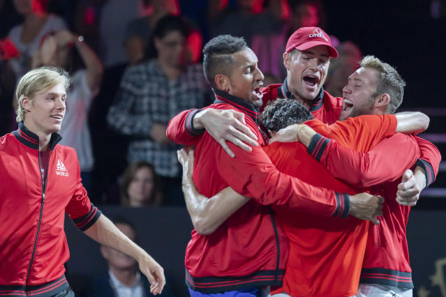 Team World's Taylor Fritz, front, celebrates winning his match against Team Europe's Dominic Thiem at the Laver Cup tennis event in Geneva, Sunday, Sept. 22, 2019. (Martial Trezzini/Keystone via AP)