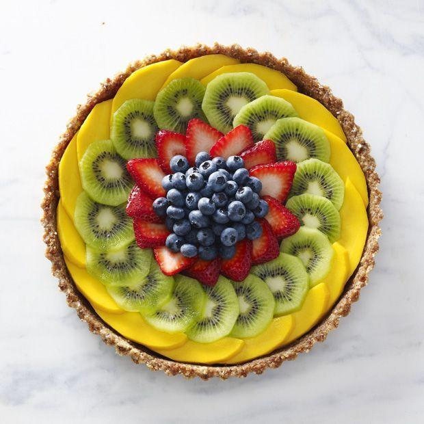 """<p>Colorful fruits piled high into a craveworthy walnut, date, and coconut crust is a dessert that can totally double as breakfast.</p><p><em><a href=""""https://www.prevention.com/food-nutrition/a20461722/vegan-dessert-recipe/"""" rel=""""nofollow noopener"""" target=""""_blank"""" data-ylk=""""slk:Get the recipe from Prevention »"""" class=""""link rapid-noclick-resp"""">Get the recipe from Prevention »</a></em> </p>"""
