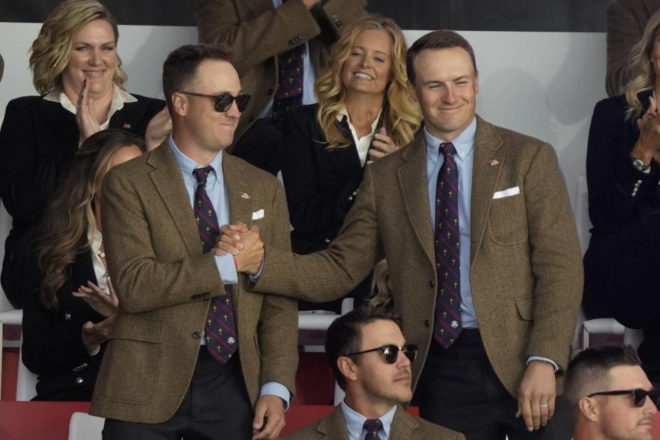 Team USA's Justin Thomas and Team USA's Jordan Spieth shake hands after it was announced they would play together in Fridays foursomes during the opening ceremony for the Ryder Cup at the Whistling Straits Golf Course Thursday, Sept. 23, 2021, in Sheboygan, Wis. (AP Photo/Charlie Neibergall)