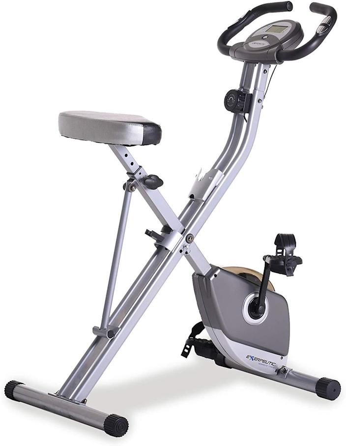 """For less than $200, here's an <a href=""""https://www.amazon.com/Exerpeutic-Folding-Magnetic-Upright-Pulse/dp/B007595TKU"""" rel=""""nofollow noopener"""" target=""""_blank"""" data-ylk=""""slk:exercise bike"""" class=""""link rapid-noclick-resp"""">exercise bike</a> you can fold up and roll off into a spare closet. With its magnetic tension control system, you can adjust the tension level for a variety of difficulty levels. We highly recommend setting it up in front of your laptop or TV so you can ride while watching some Netflix, which, bonus: This machine is quiet enough to not disturb your programs. The bike even features an LCD display that indicates distance, calories burned, time, speed, scan, and heart rate."""