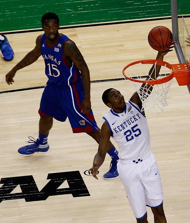 Marquis Teague #25 of the Kentucky Wildcats lays the ball up against Elijah Johnson #15 of the Kansas Jayhawks in the first half in the National Championship Game of the 2012 NCAA Division I Men's Basketball Tournament at the Mercedes-Benz Superdome on April 2, 2012 in New Orleans, Louisiana. (Photo by Chris Graythen/Getty Images)
