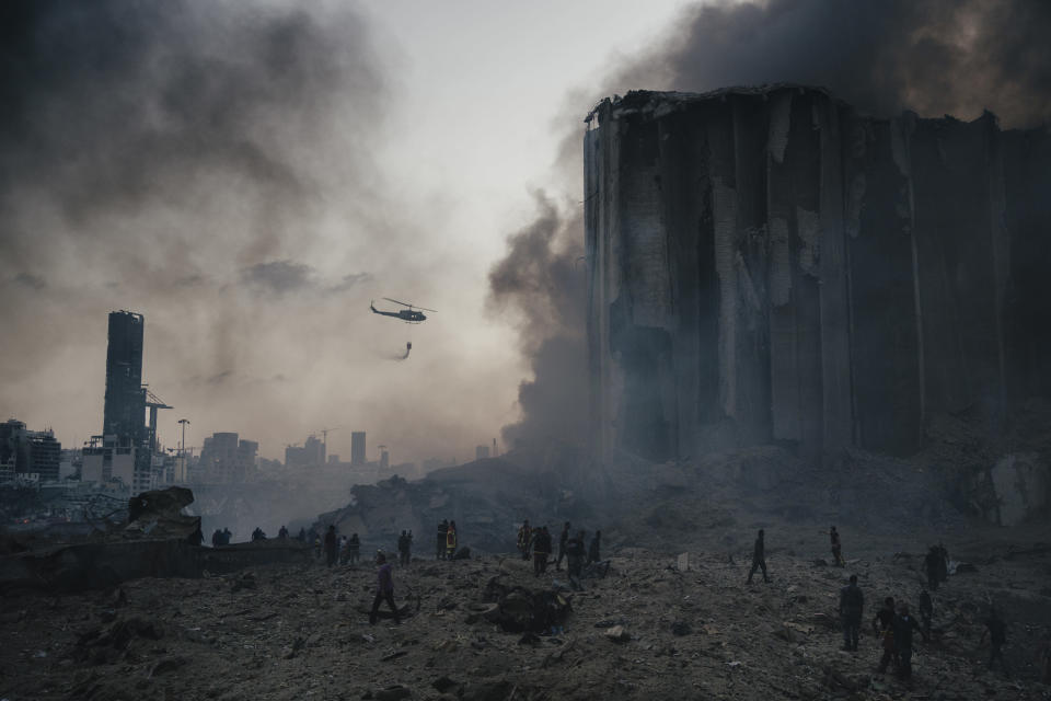 In this image released by World Press Photo, Thursday April 15, 2021, by Lorenzo Tugnoli, Contrasto, for The Washington Post, part of a series titled Port Explosion in Beirut, which won first prize in the Spot News Stories category, shows Firefighters work to put out the fires that engulfed warehouses in Beirut, Lebanon, on August 4, 2020, after a massive explosion in the port. Up to ten firefighters died in the blast. (Lorenzo Tugnoli, Contrasto, for The Washington Post, World Press Photo via AP)