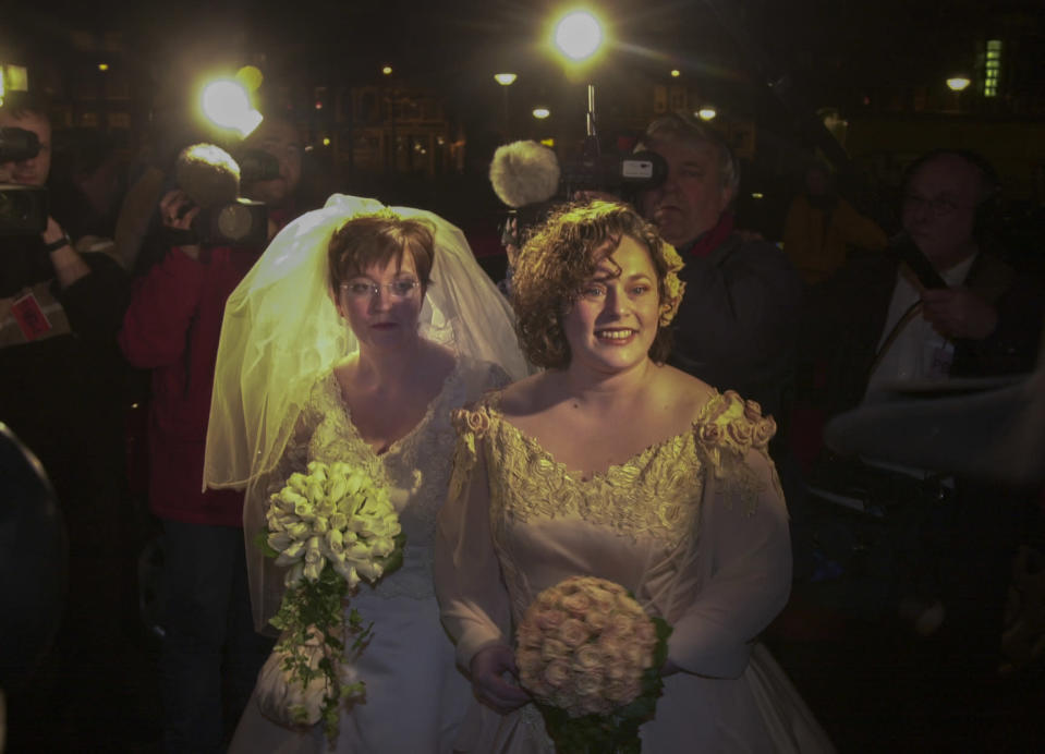 Helene Faasen, left, and Anne-Marie Thus arrive at Amsterdam's City Hall early Sunday, April 1, 2001. The pair was among four couples to get married under a new law which took effect April 1, the world's first such law allowing same-sex marriages with equal rights. (AP Photo/Peter Dejong)