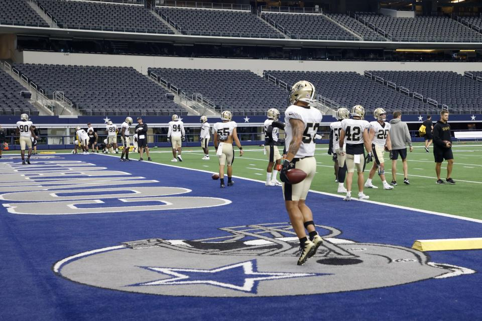The New Orleans Saints participate in an NFL football workout at AT&T Stadium in Arlington, Texas, Monday, Aug. 30, 2021. Displaced by Hurricane Ida, the Saints went back to work Monday about 500 miles away in the home of another NFL team. (AP Photo/Michael Ainsworth)