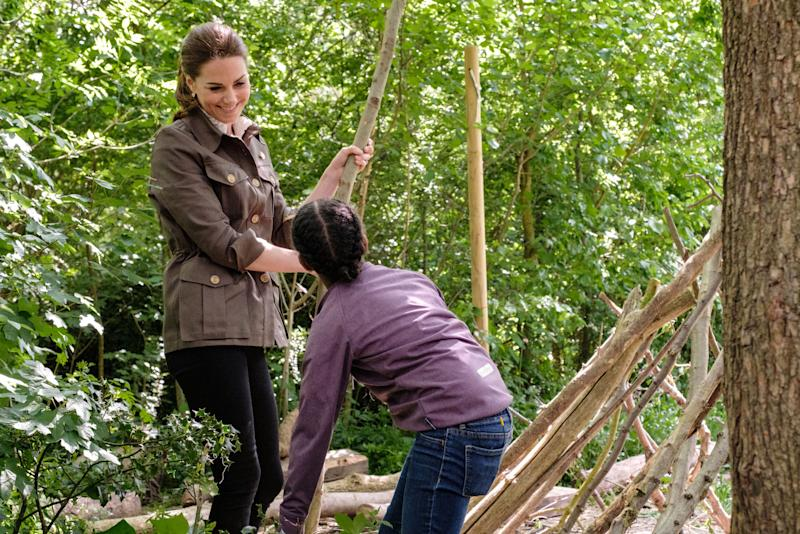 The film shows Kate helping the children to build a den. [Photo: BBC]
