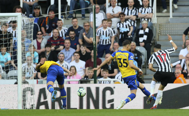 Newcastle United's Ayoze Perez, right, scores his side's first goal of the game of the game against Southampton, during their English Premier League soccer match at St James' Park in Newcastle, England, Saturday April 20, 2019. (Richard Sellers/PA via AP)