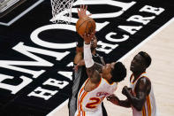 Atlanta Hawks' John Collins (20) attempts to score against Sacramento Kings' Buddy Hield, left, during the first half of an NBA basketball game on Saturday, March 13, 2021, in Atlanta. (AP Photo/Brynn Anderson)