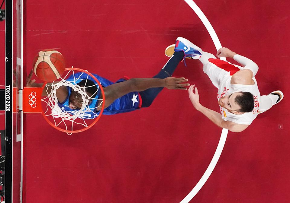 <p>Draymond Green #14 of Team United States drives to the basket against Victor Claver #10 of Team Spain during the first half of a Men's Basketball Quarterfinal game on day eleven of the Tokyo 2020 Olympic Games at Saitama Super Arena on August 03, 2021 in Saitama, Japan. (Photo by Bryan Snyder - Pool/Getty Images)</p>