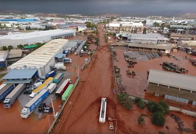 <p>General aerial view of a flooded area following flash floods in Mandra, West Attica, Greece, Nov. 15, 2017 in this still image taken from social media video. (Photo: National and Kapodistrian University of Athens via Reuters) </p>