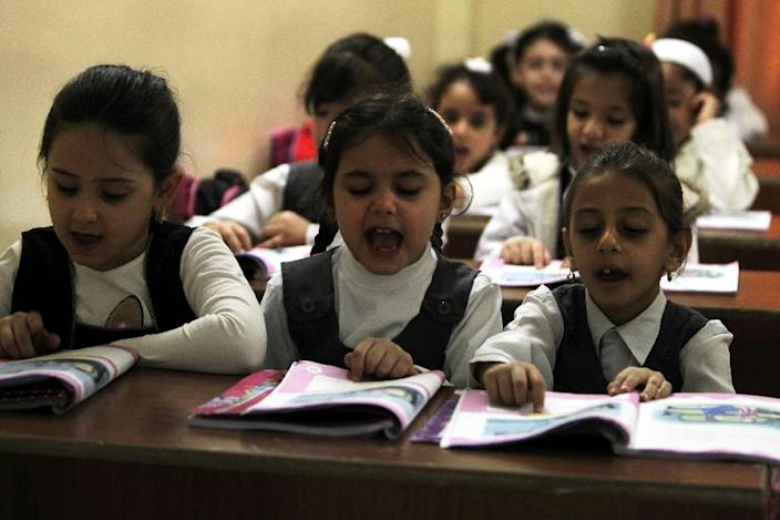 Iraqi children study at the Mariamana school in the multi-ethnic city of Kirkuk on October 26, 2015, where Kurdish, Arab and Turkmen children sit in the same classrooms and Islamic and Christian education textbooks are stacked on the same tables (AFP Photo/Ahmad Al-Rubaye)