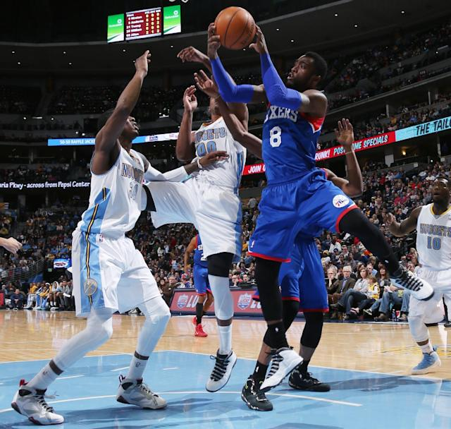 Philadelphia 76ers guard Troy Wroten, right, drives for shot as Denver Nuggets forwards Darrell Arthur, left, and Quincy Miller defend during the first quarter of an NBA basketball game in Denver on Wednesday, Jan. 1, 2014. (AP Photo/David Zalubowski)