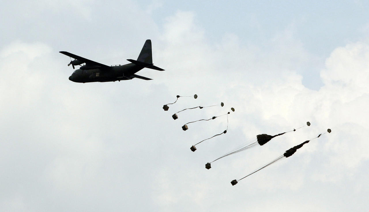 In this photo taken Tuesday, June 19, 2012, a South Korea's C-130 cargo plane drops the military supply goods during a South Korea-U.S. joint military live-fire drills at Seungjin Fire Training Field in Pocheon, South Korea, near the border with the North Korea. The drills were held in a show of combat readiness ahead of the 62nd anniversary of the start of the Korean War on June 25. (AP Photo/Lee Jin-man)