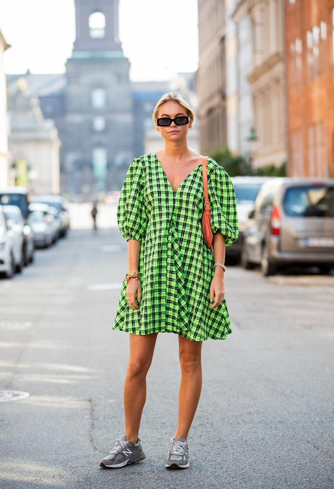 <p>Keep it casual in a plaid dress and New Balance sneakers.</p>