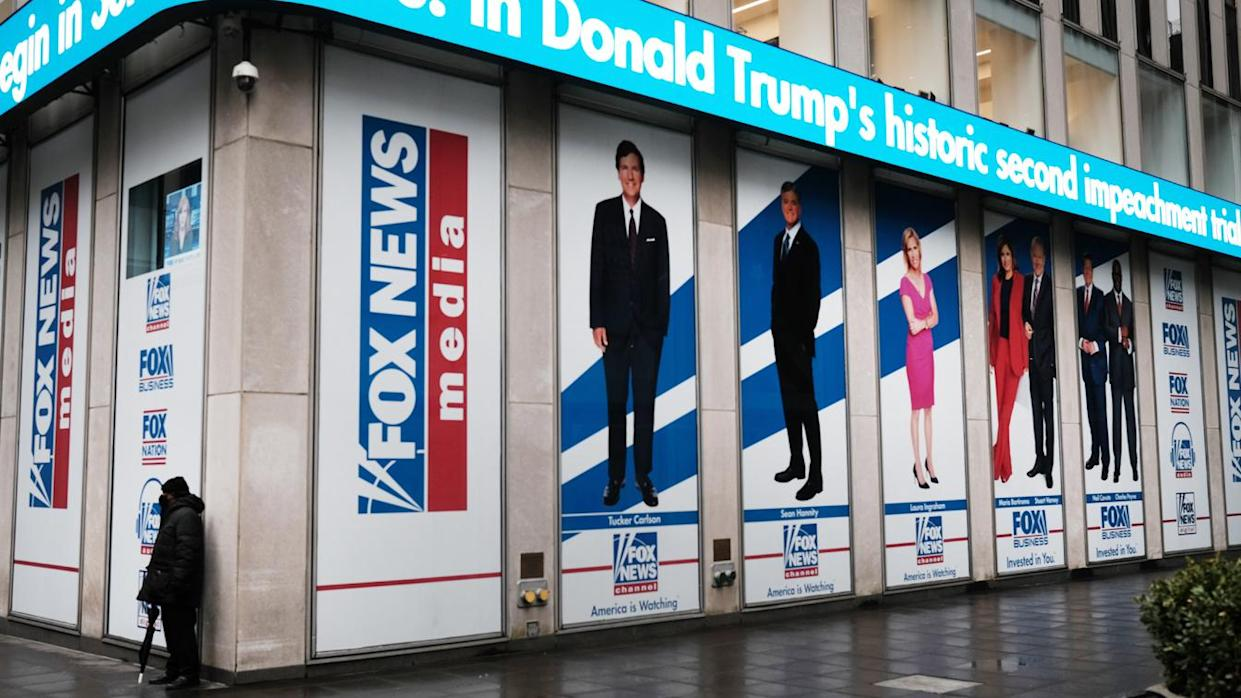 Heeadlines on former President Donald Trump's second impeachment trial are displayed at the New York headquarters of Fox in February.