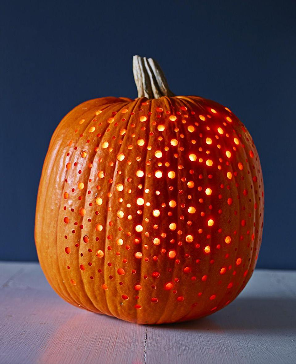 """<p>It may <em>look</em> elaborate, but this polka-dot pattern is fairly easy. Sketch your pattern with a marker, leaving enough space between dots so holes won't overlap. Punch it out with a power drill and various bits. Finish it off by placing LED string lights inside to bask in your handiwork's glow. </p><p><a class=""""link rapid-noclick-resp"""" href=""""https://www.amazon.com/Tesyker-Fairy-Lights-Multicolor-Waterproof/dp/B07C3N6KMF/?tag=syn-yahoo-20&ascsubtag=%5Bartid%7C10055.g.238%5Bsrc%7Cyahoo-us"""" rel=""""nofollow noopener"""" target=""""_blank"""" data-ylk=""""slk:SHOP STRING LIGHTS"""">SHOP STRING LIGHTS</a></p>"""