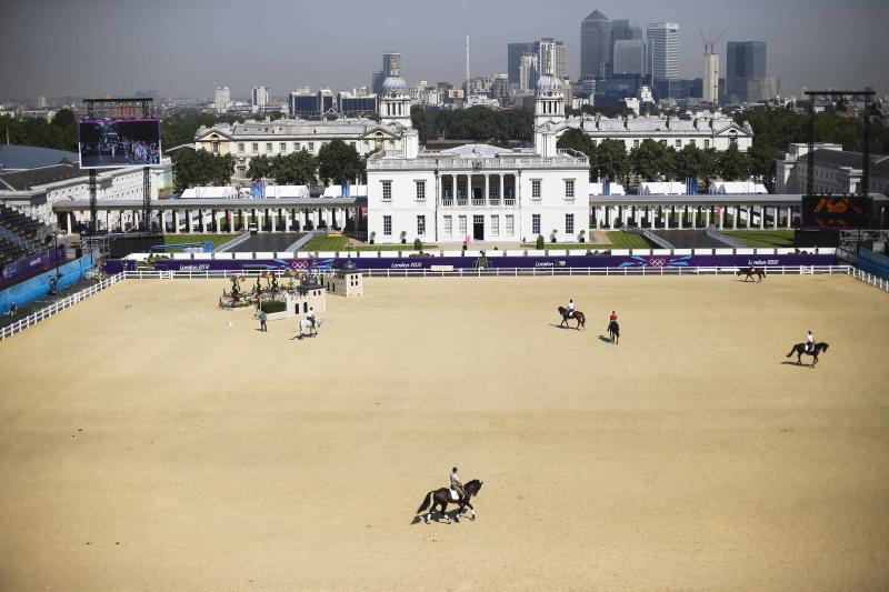 Equestrians train with their horses at Greenwich Park for the 2012 Summer Olympics, Wednesday, July 25, 2012, in London. The city will host the 2012 London Olympics with opening ceremonies scheduled for Friday, July 27. (AP Photo/Markus Schreiber)