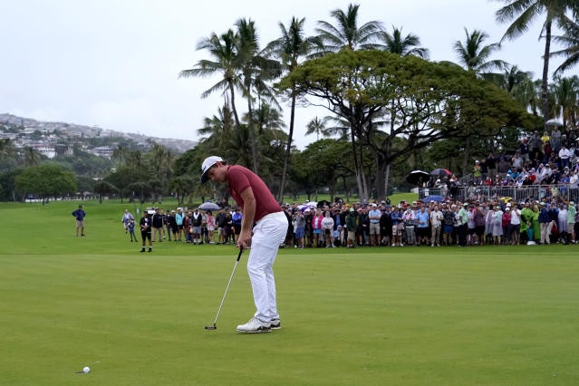 Cameron Smith makes his birdie putt on the 18th green to force a one-hole playoff against Brendan Steele during the final round of the Sony Open PGA Tour golf event, Sunday, Jan. 12, 2020, at Waialae Country Club in Honolulu. (AP Photo/Matt York)