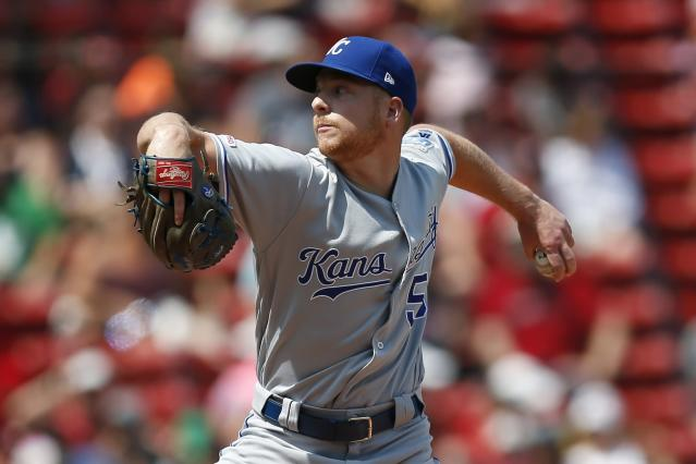 Kansas City Royals' Richard Lovelady pitches during the 10th inning of a baseball game against the Boston Red Sox that was suspended by rain with the scored tied on Aug. 8, and continued at Fenway Park in Boston, Thursday, Aug. 22, 2019. (AP Photo/Michael Dwyer)