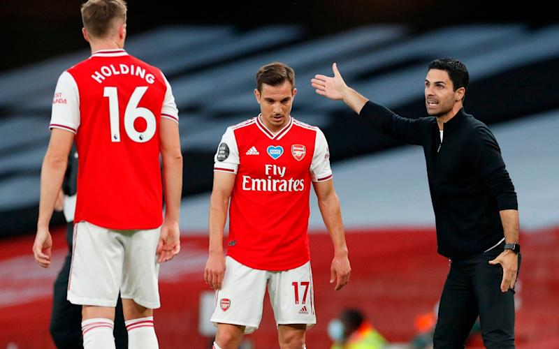 Arsenal receive instructions from manager Mikel Arteta - AFP