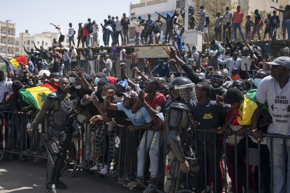Demonstrators shout slogans during a protest against the arrest of opposition leader and former presidential candidate Ousmane Sonko near the Justice Palace of Dakar, Senegal, Monday, March 8, 2021. A Senegalese court cleared the way Monday for Sonko's release pending his rape trial in a case that already has sparked deadly protests and threatened to erode the country's reputation as one of West Africa's most stable democracies. (AP Photo/Leo Correa)