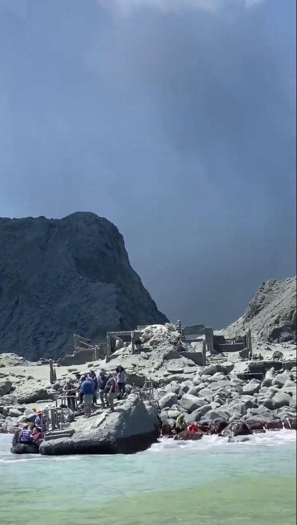Tourists and tour guides fleeing White Island as it erupts. Source: AAP