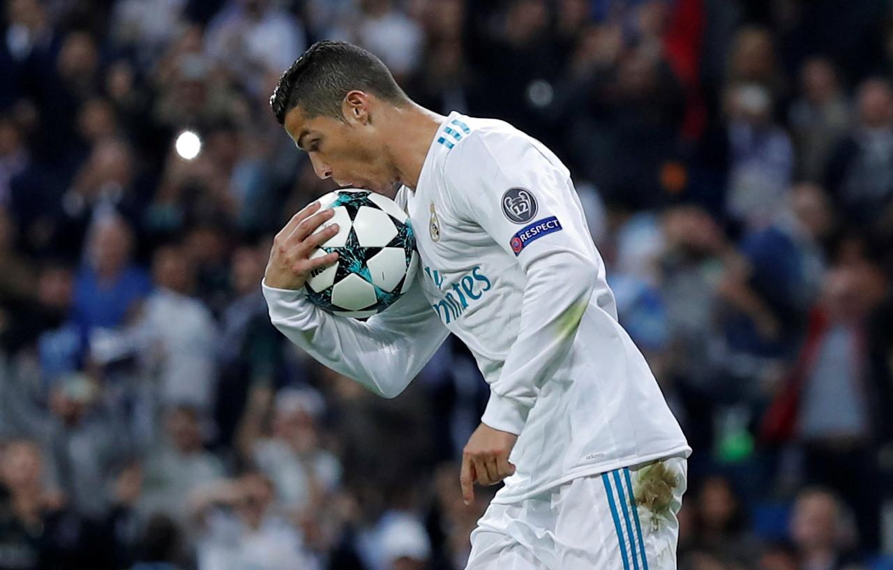 Soccer Football - Champions League - Real Madrid vs Tottenham Hotspur - Santiago Bernabeu Stadium, Madrid, Spain - October 17, 2017   Real Madrid's Cristiano Ronaldo celebrates scoring their first goal from the penalty spot    Action Images via Reuters/Andrew Couldridge