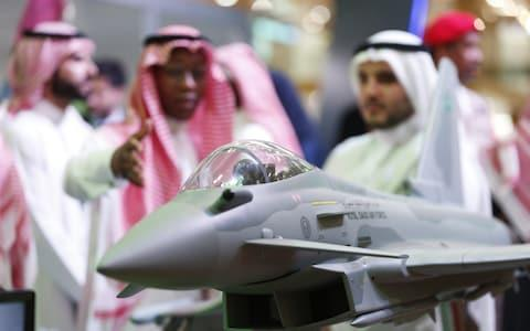 <span>Visitors look at a display model of a Saudi Air Force Eurofighter Typhoon jet, manufactured by BAE Systems, in Riyadh, Saudi Arabia, in February</span> <span>Credit: Mohammed Almuaalemi/Bloomberg </span>