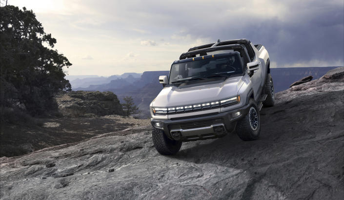 This photo provided by GMC shows the GMC Hummer EV, an electric pickup which will relaunch the Hummer brand. With lots of off-road potential and 1,000 horsepower on tap, the Hummer EV certainly makes a bold statement. (Courtesy of GMC via AP)
