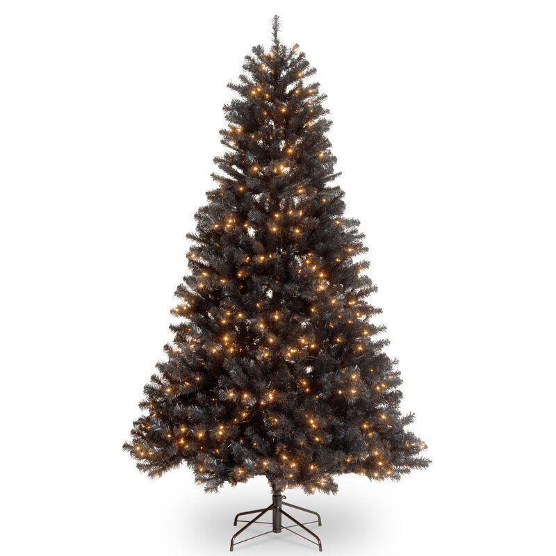 """<p><strong>The Holiday Aisle</strong></p><p>wayfair.com</p><p><strong>$179.99</strong></p><p><a href=""""https://go.redirectingat.com?id=74968X1596630&url=https%3A%2F%2Fwww.wayfair.com%2Fholiday-decor%2Fpdp%2Fthe-holiday-aisle-north-valley-7-black-spruce-christmas-tree-with-500-clearwhite-lights-ntc4468.html&sref=https%3A%2F%2Fwww.housebeautiful.com%2Fentertaining%2Fholidays-celebrations%2Fg4010%2Fbest-artificial-christmas-trees%2F"""" rel=""""nofollow noopener"""" target=""""_blank"""" data-ylk=""""slk:BUY NOW"""" class=""""link rapid-noclick-resp"""">BUY NOW</a></p><p>Yep, that's right—black Christmas trees are a thing, and they're super chic. Go with this untraditional choice, and you'll have the perfect canvas for <a href=""""https://www.housebeautiful.com/entertaining/holidays-celebrations/g3851/halloween-christmas-tree/"""" rel=""""nofollow noopener"""" target=""""_blank"""" data-ylk=""""slk:Halloween decorations"""" class=""""link rapid-noclick-resp"""">Halloween decorations</a> in October, too.</p>"""