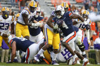 Auburn running back Tank Bigsby (4) carries the ball in for a touchdown against LSU during the second half of an NCAA college football game on Saturday, Oct. 31, 2020, in Auburn, Ala. (AP Photo/Butch Dill)