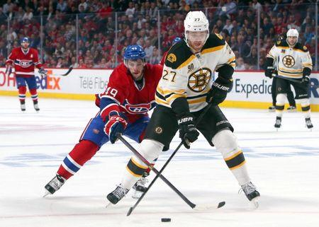 May 12, 2014; Montreal, Quebec, CAN; Montreal Canadiens left wing Michael Bournival (49) and Boston Bruins defenseman Dougie Hamilton (27) battle for the puck during the third period in the game six of the second round of the 2014 Stanley Cup Playoffs at Bell Centre. Mandatory Credit: Jean-Yves Ahern-USA TODAY Sports