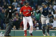 Boston Red Sox's Mitch Moreland, center, reacts beside Tampa Bay Rays' Mike Zunino, right, after striking out during the ninth inning to end a baseball game in Boston, Saturday, April 27, 2019. (AP Photo/Michael Dwyer)