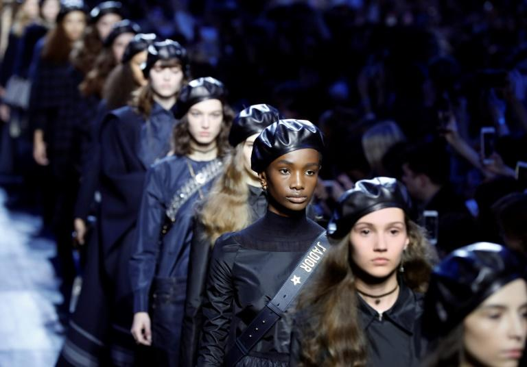 Models present creations by Christian Dior during the women's Fall-Winter 2017-2018 ready-to-wear collection fashion show in Paris on March 3, 2017