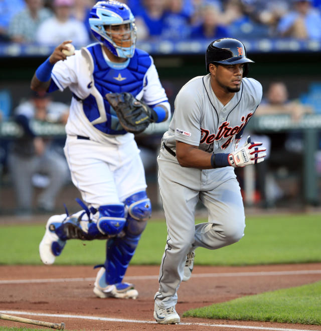 Kansas City Royals catcher Martin Maldonado, left, completes the strike out of Detroit Tigers' Jeimer Candelario during the first inning of a baseball game at Kauffman Stadium in Kansas City, Mo., Friday, July 12, 2019. (AP Photo/Orlin Wagner)
