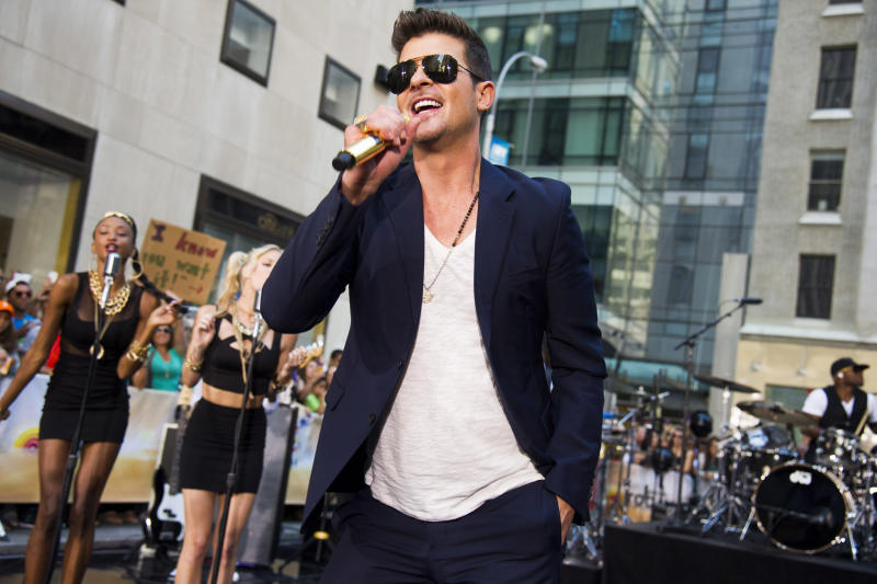 "FILE - In this July 30, 2013 file photo, Robin Thicke performs on NBC's ""Today"" show in New York. The Recording Academy announced Wednesday, Oct. 8, 2013 that Drake, Robin Thicke and Macklemore & Ryan Lewis will perform at the Grammy Awards nominations special show Dec. 6 at the Nokia Theatre L.A. Live in Los Angeles. The one-hour special will air live on CBS. (Photo by Charles Sykes/Invision/AP, File)"