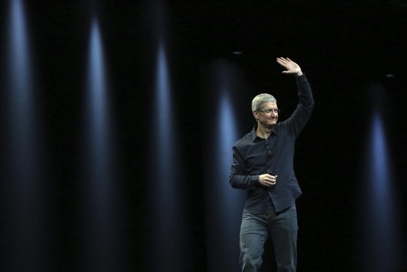 Apple CEO Tim Cook gestures as he leaves the stage following his keynote address at the Worldwide Developers Conference in San Francisco