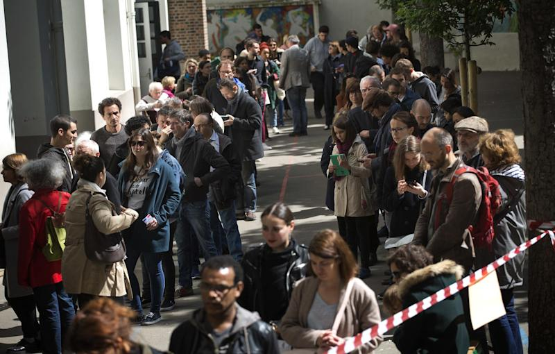 French voters queue at a Parisien polling station: AP