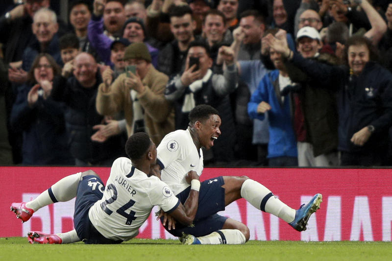 Tottenham's Steven Bergwijn, right, celebrates with Serge Aurier after scoring the opening goal during the English Premier League soccer match between Tottenham Hotspur and Manchester City at the Tottenham Hotspur Stadium in London, England, Sunday, Feb. 2, 2020. (AP Photo/Ian Walton)