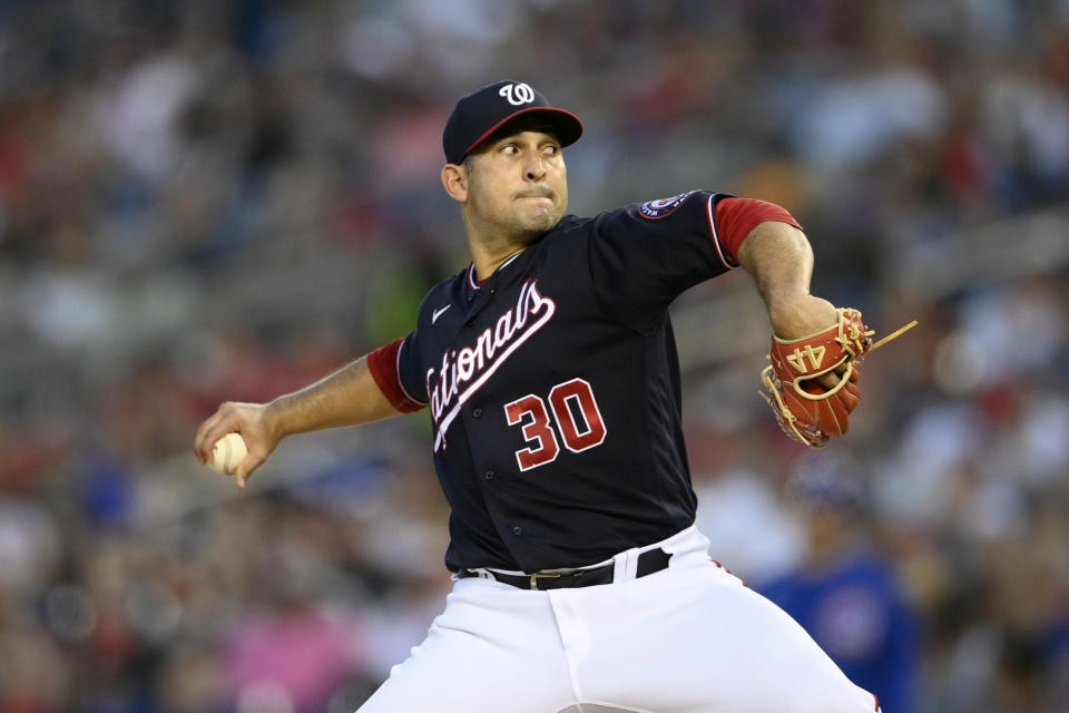 Washington Nationals starting pitcher Paolo Espino winds up during the fourth inning of the team's baseball game against the Chicago Cubs, Friday, July 30, 2021, in Washington. (AP Photo/Nick Wass)