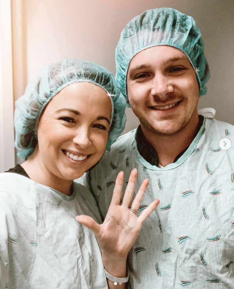 Breanna Lockwood poses with husband AAron in hospital scrubs during IVF attempts