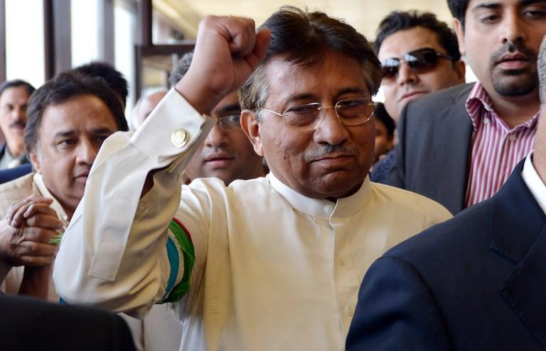 Pakistan's former military ruler Pervez Musharraf gestures upon his arrival at the Karachi International airport from Dubai, in Karachi on March 24, 2013. Pakistan's former military ruler Pervez Musharraf returned home after more than four years in exile, defying a Taliban death threat to contest historic general elections. AFP PHOTO/ AAMIR QURESHI