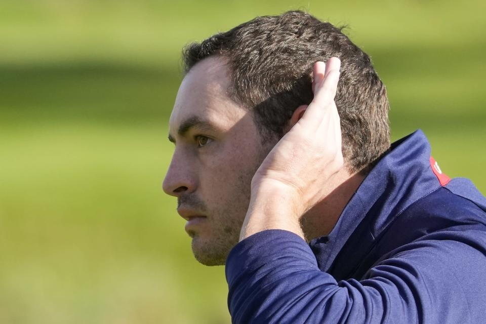 Team USA's Patrick Cantlay tries to get the crowd going on the ninth hole during a foursomes match the Ryder Cup at the Whistling Straits Golf Course Saturday, Sept. 25, 2021, in Sheboygan, Wis. (AP Photo/Charlie Neibergall)