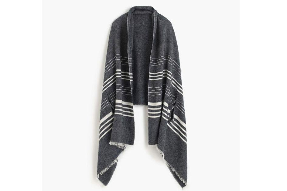 "<p>Buy it: $39.50; <a rel=""nofollow"" href=""https://www.jcrew.com/p/womens_category/accessories/scarves/striped-cape-scarf/h0129?isFromSearch=true&color_name=navy-ivory&N=0&Nloc=en&Ntrm=cape&Npge=1&Nrpp=60&Nsrt=0&hasSplitResults=false&mode=sidecar"">jcrew.com</a></p> <p>Throw this easily packable scarf in your carry-on to weather unexpectedly chilly flights.</p>"