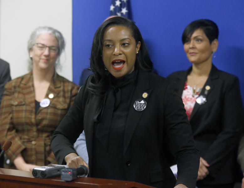 FILE - Jan. 22, 2019 file photo, Del. Jennifer Carroll Foy, D-Prince William, center, speaks during a news conference of ERA (Equal Rights Amendment) supporters after her ERA bill was killed by a House subcommittee inside the Pocahontas Building in Richmond, Va.   Supporters of the Equal Rights Amendment are confident Virginia is on the verge of becoming the critical 38th state to ratify the gender equality measure.  The proposed 28th amendment to the U.S. Constitution faces a host of likely legal challenges and vehement opposition from conservative activists who depict the ERA as a threat to their stances on abortion and transgender rights. (Bob Brown/Richmond Times-Dispatch via AP)