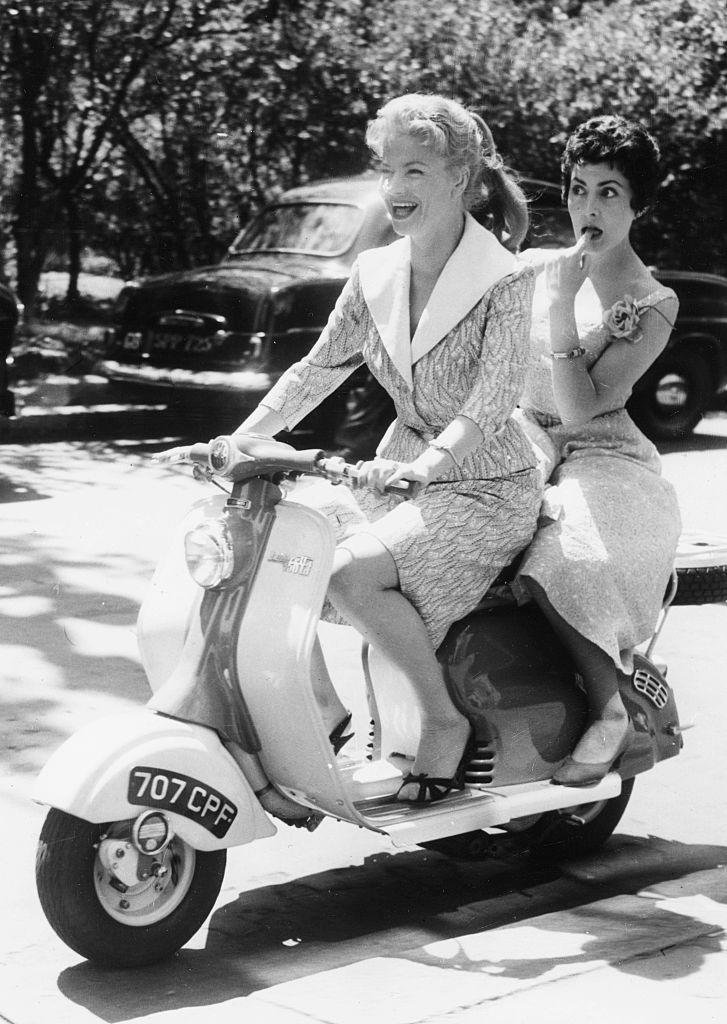 "<p>Actresses Anna Marie Mersen (driving) and Claude Godard, riding a motor scooter on a sightseeing tour of London.</p><p>Other celebrity visitors this year:<span class=""redactor-invisible-space""> Jayne Mansfield, actress Jean Seberg, Marilyn Monroe.<br></span></p>"