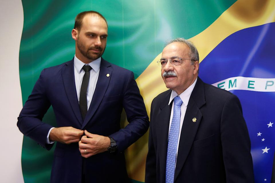 Brazil's Federal Deputy Eduardo Bolsonaro reacts next Senator Chico Rodrigues at the Federal Senate in Brasilia, Brazil August 9, 2019. Picture taken August 9, 2019. REUTERS/Adriano Machado
