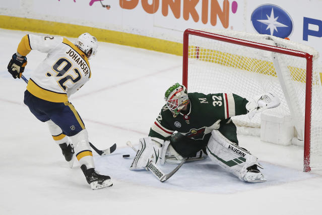 Nashville Predators' Ryan Johansen shoots the game-winning goal against Minnesota Wild goalie Alex Stalock during a shootout in an NHL hockey game Sunday, March 3, 2019, in St. Paul, Minn. The Predators won 3-2 in a shootout. (AP Photo/Stacy Bengs)