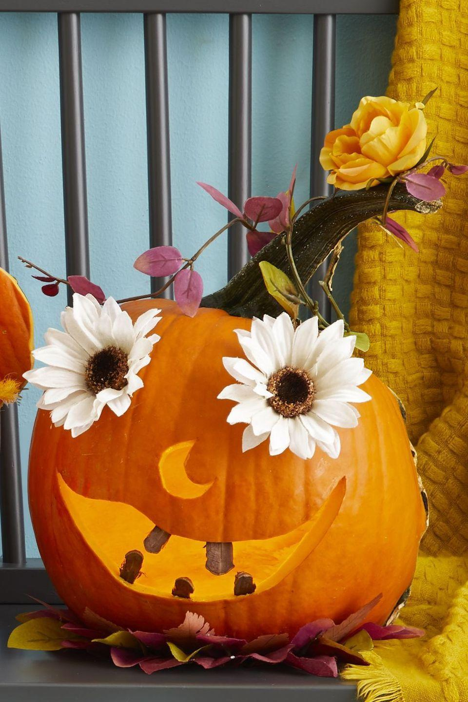 """<p>Sunflower seeds, pinecones, dried leaves, and artificial flowers bring this toothy pumpkin to life. You can even forage for some of these supplies in your own backyard.</p><p><a class=""""link rapid-noclick-resp"""" href=""""https://go.redirectingat.com?id=74968X1596630&url=https%3A%2F%2Fwww.walmart.com%2Fsearch%2F%3Fquery%3Dcraft%2Bpinecones&sref=https%3A%2F%2Fwww.thepioneerwoman.com%2Fhome-lifestyle%2Fcrafts-diy%2Fg36982763%2Fpumpkin-carving-ideas%2F"""" rel=""""nofollow noopener"""" target=""""_blank"""" data-ylk=""""slk:SHOP CRAFT PINECONES"""">SHOP CRAFT PINECONES</a></p>"""