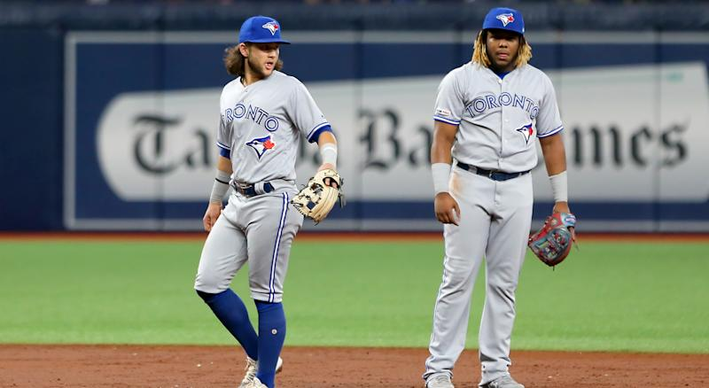 ST. PETERSBURG, FL - AUG 05: Bo Bichette (11) of the Blue Jays and Vladimir Guerrero Jr. (27) on defense during the MLB regular season game between the Toronto Blue Jays and the Tampa Bay Rays on August 05, 2019, at Tropicana Field in St. Petersburg, FL. (Photo by Cliff Welch/Icon Sportswire via Getty Images)