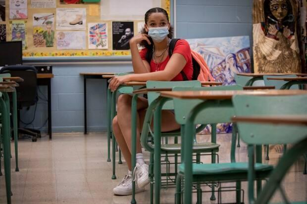 Isabella Kitchin, 15, sits in a Toronto classroom in this file photo. The CBE will mandate masks when students return to school this fall.  (Evan Mitsui/CBC - image credit)